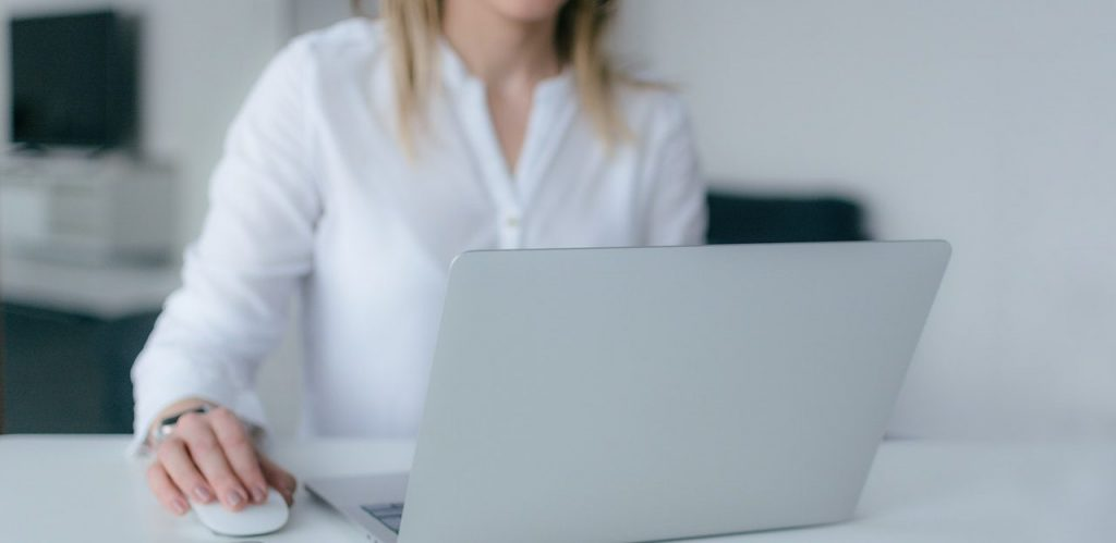 Woman in white typing