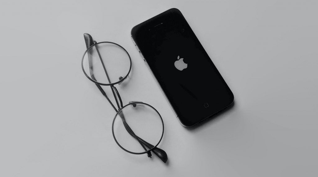 Image of Apple phone and glasses