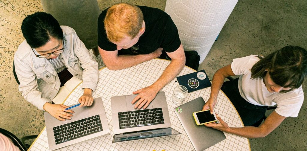 Image of people in office with laptop