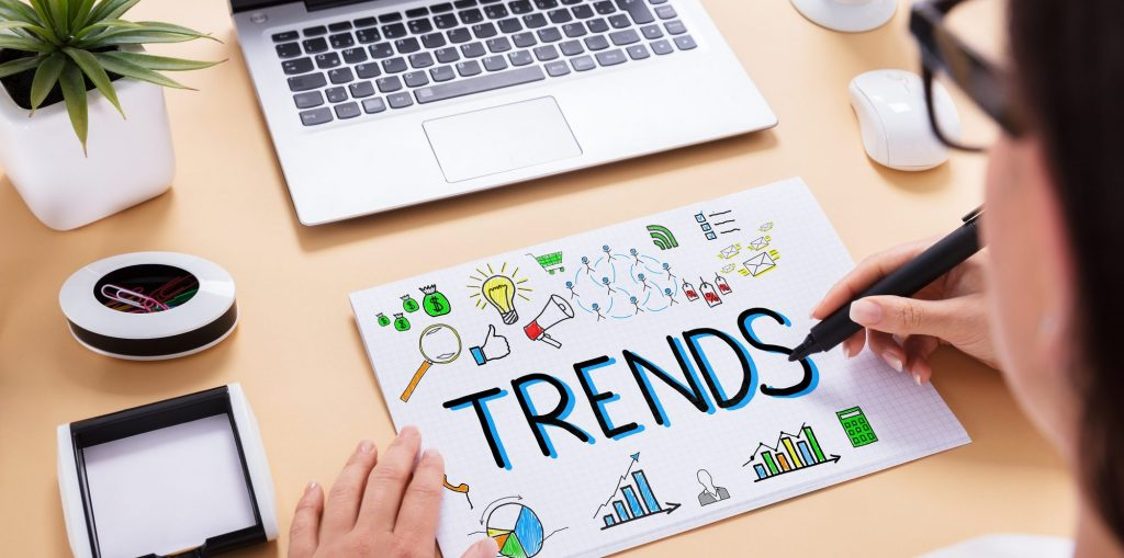 Businessperson Drawing Trends Chart On Office Desk