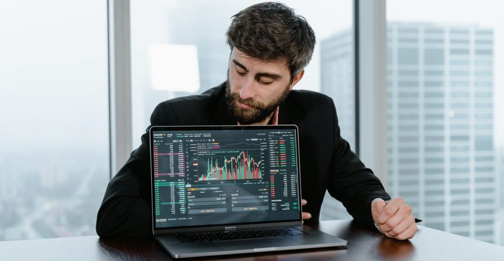 Man in black long sleeve shirt using black laptop computer