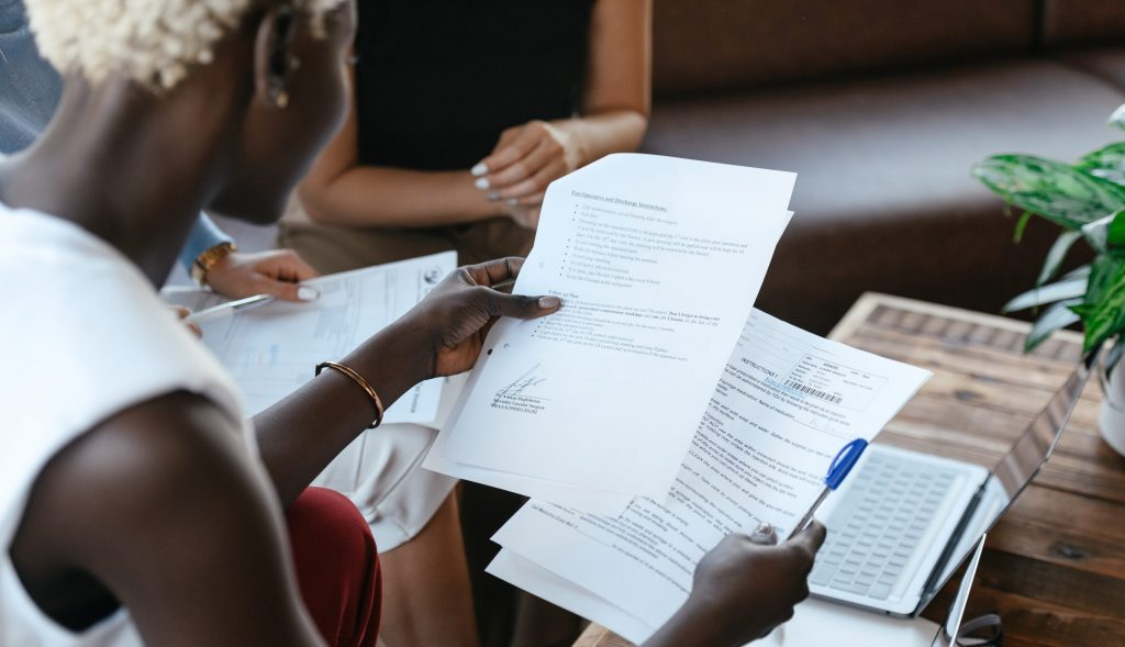 Black woman reading information of important document