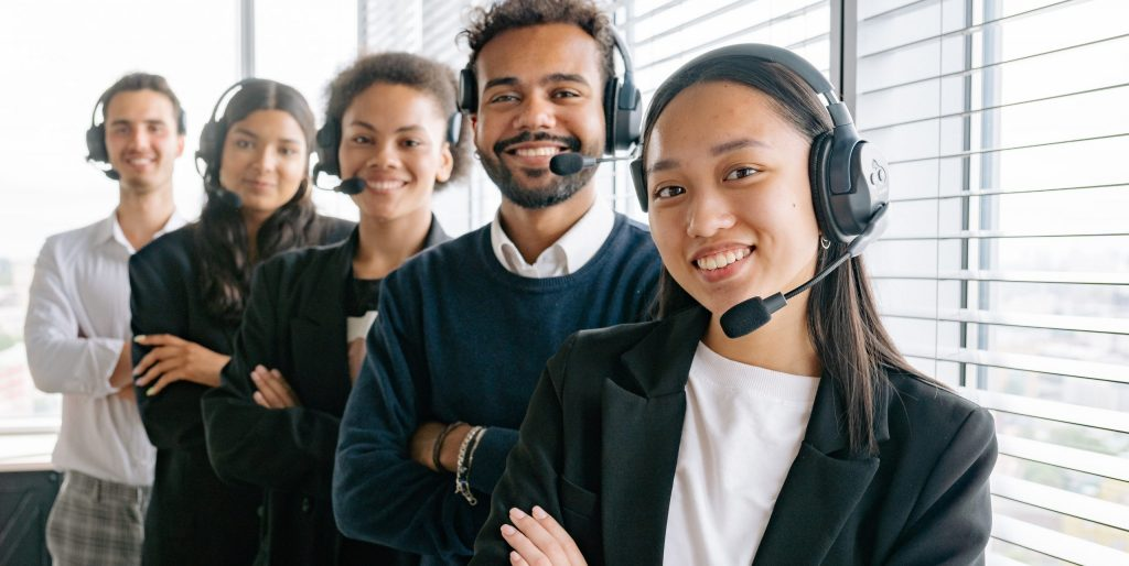 Happy call center agents looking at camera